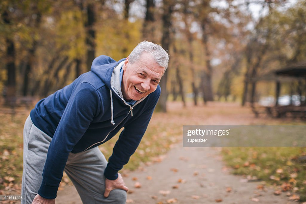Senior man exercizing outdoors : Stock Photo
