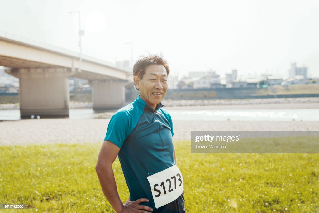 Senior man exhausted after running a marathon : Stock Photo