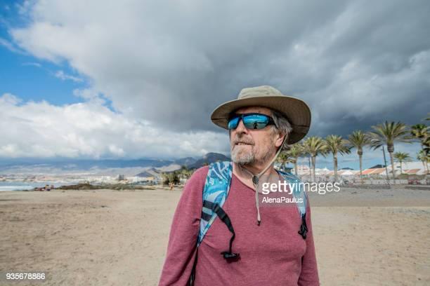 Senior man exploring Tenerife Beach Playa de Las Americas