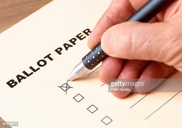 senior man filling in ballot form - ballot slip stock pictures, royalty-free photos & images