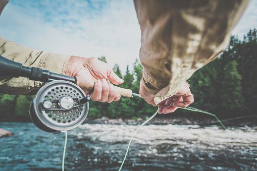 POV Senior Man Fisherman Fly Fishing in A River 888503546