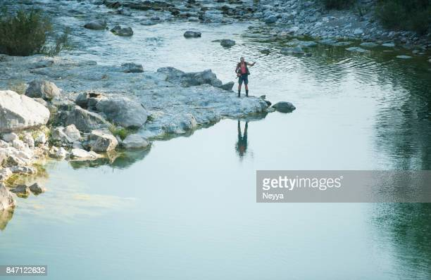 senior man fishing on the soča river, slovenia - spring flowing water stock pictures, royalty-free photos & images