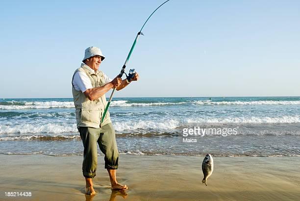 Senior man fishing.