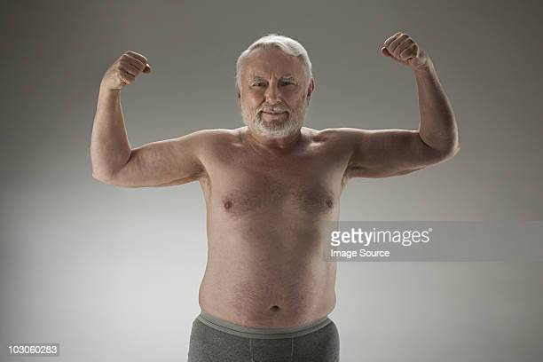 senior man flexing muscles - hairy chest stock photos and pictures
