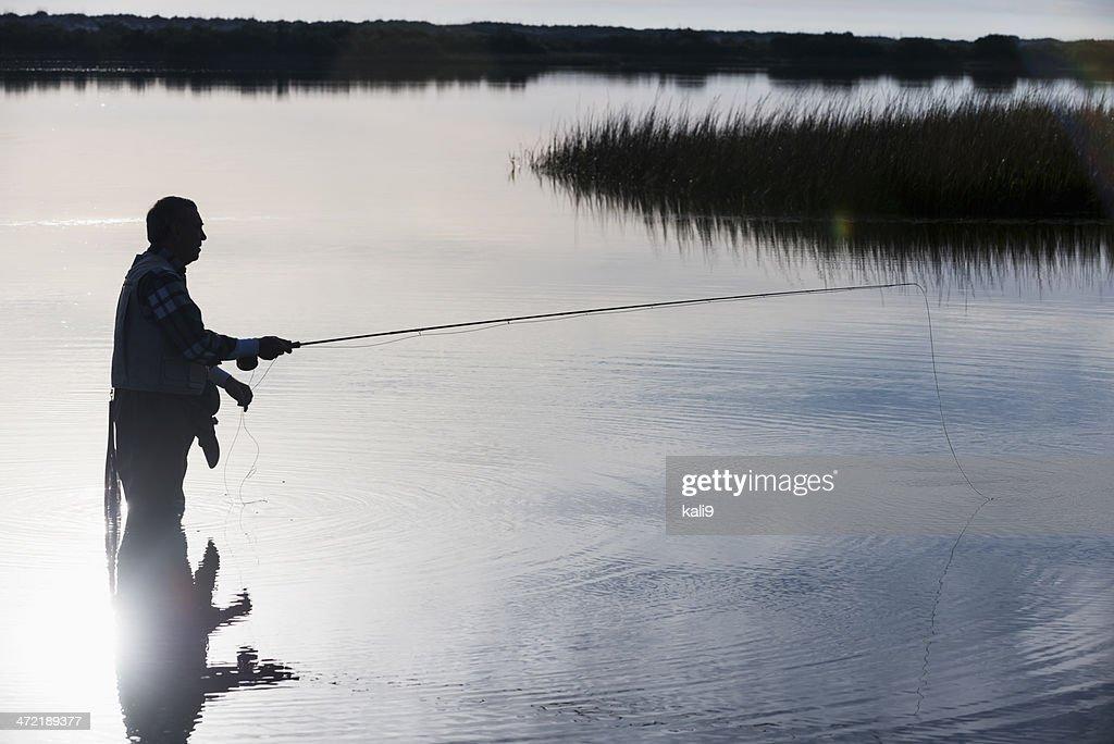 Senior man fly fishing : Stock Photo