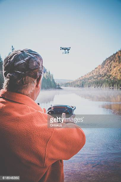 Senior Man Flying a Drone in Forest