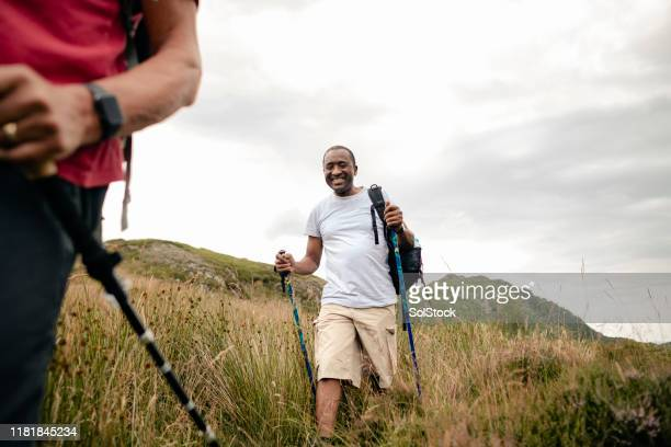 senior man following in group of people hiking - escaping stock pictures, royalty-free photos & images