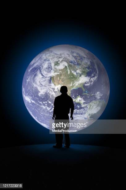 senior man from behind watching the planet earth from outer space - waiting stock pictures, royalty-free photos & images
