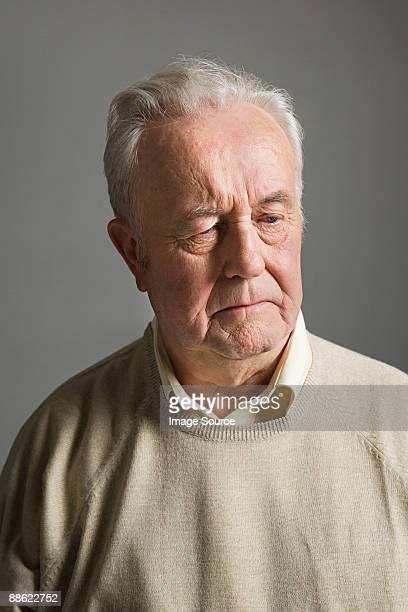Senior man frowning