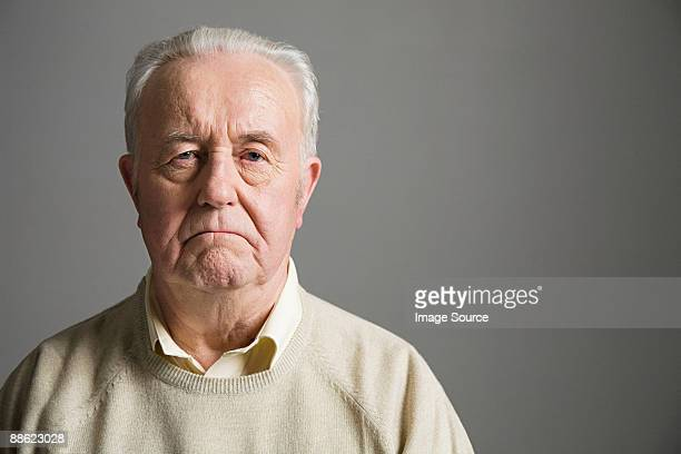 senior man frowning - frowning stock pictures, royalty-free photos & images