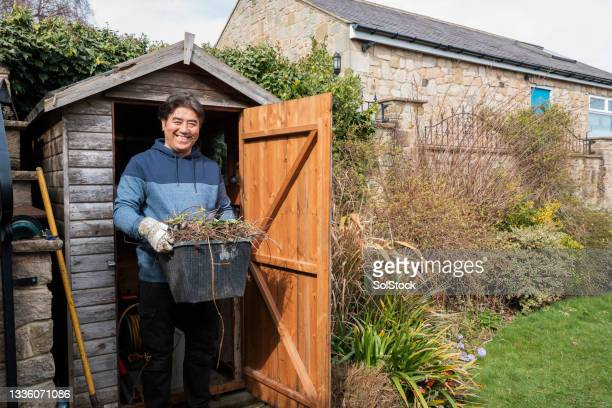 senior man gardening at home - one senior man only stock pictures, royalty-free photos & images