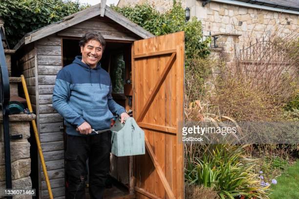 senior man gardening - one senior man only stock pictures, royalty-free photos & images