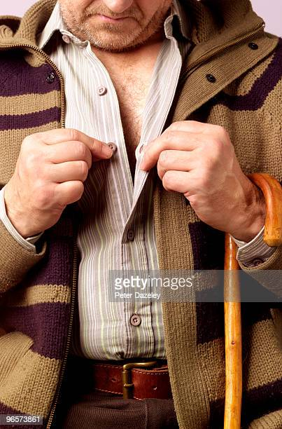 Senior man getting dressed with parkinson's