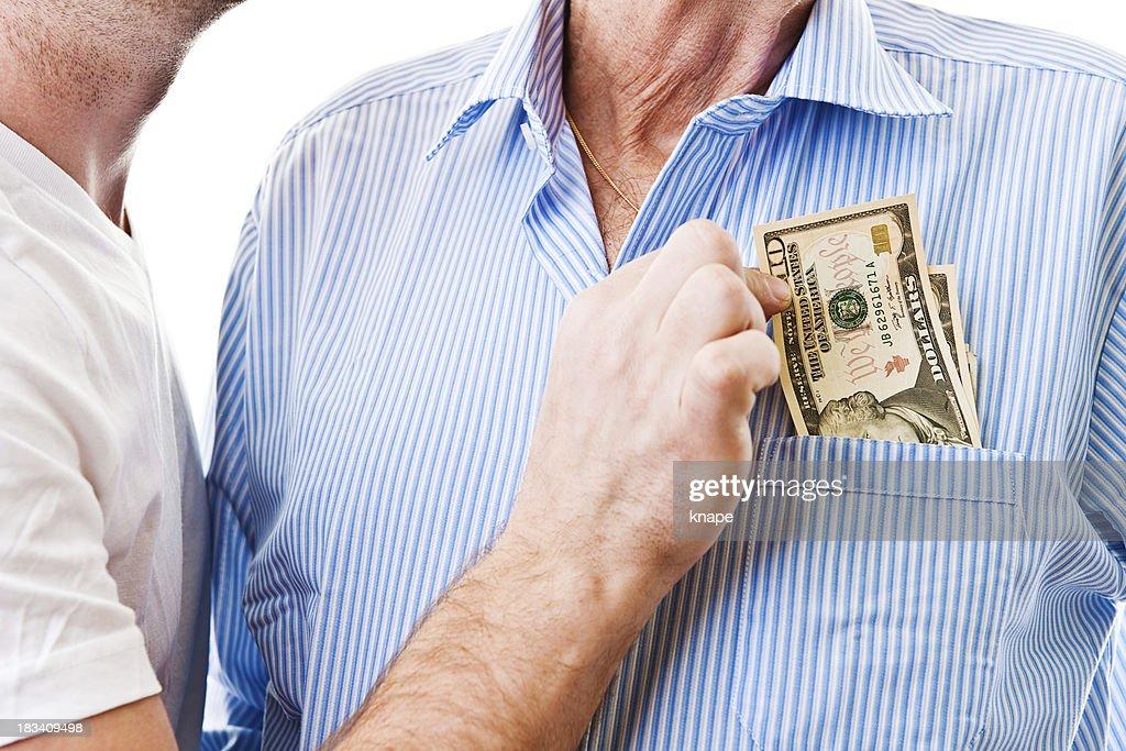 Senior man getting his pension stolen : Stock Photo