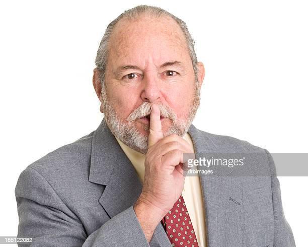 Senior Man Gives Hush Quiet Finger Gesture