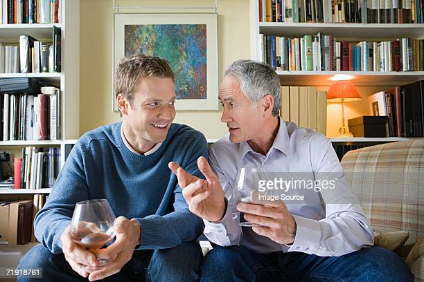 Senior man giving advice to younger man