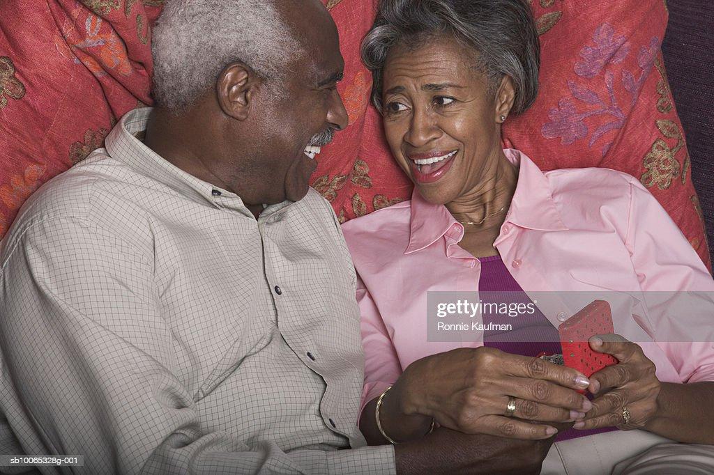 Senior man giving gift to woman : Foto stock