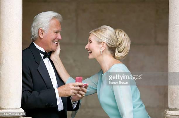 senior man giving senior woman ring, smiling, side view - de amado carrillo fuentes fotografías e imágenes de stock