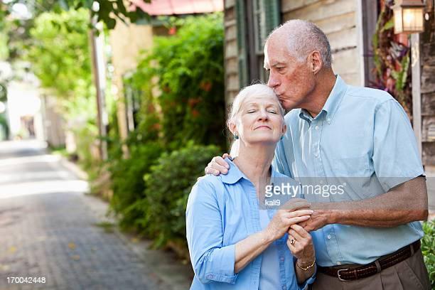 Senior man giving wife a kiss