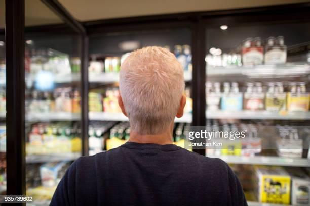 Senior man goes grocery shopping.