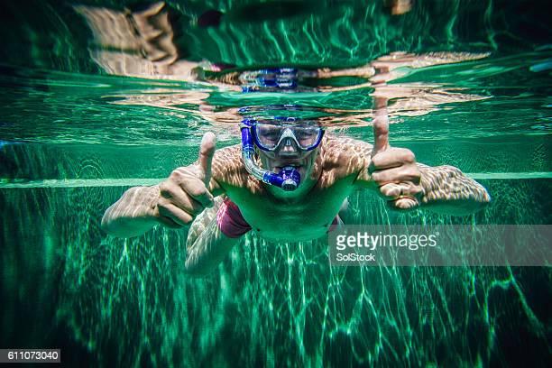 Senior Man Happily Swimming Underwater