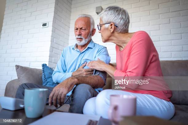 senior man have heart problems - heartburn stock photos and pictures