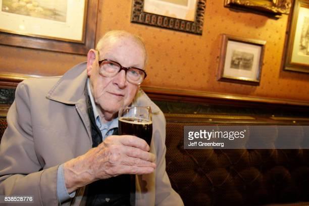 Senior man having a drink at The Darrowby Inn.