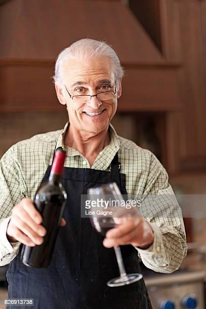 Senior man having a glass of wine