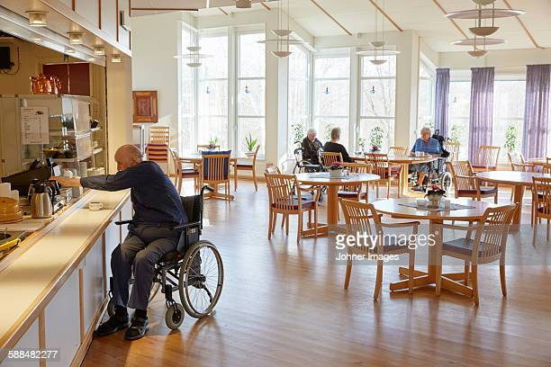 Senior man having coffee in dining room