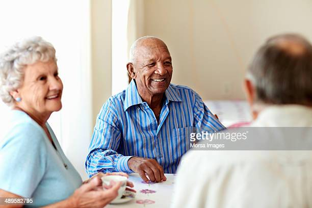 senior man having coffee with friends - 80 89 years stock pictures, royalty-free photos & images
