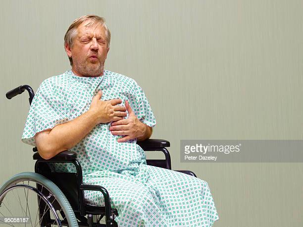 senior man having heart attack in A and E
