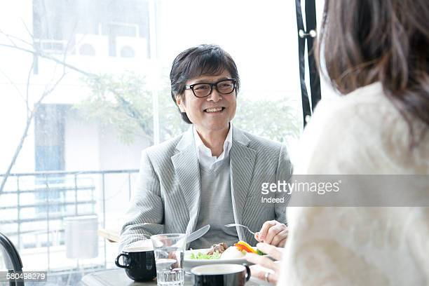 Senior man having lunch with his wife