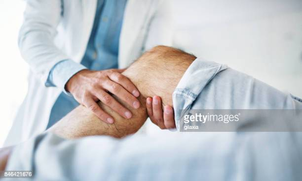 senior man having medical exam. - leg stock pictures, royalty-free photos & images