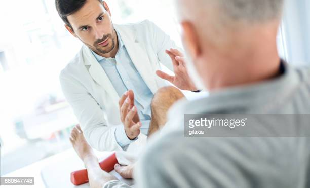 senior man having medical exam. - tendon stock photos and pictures