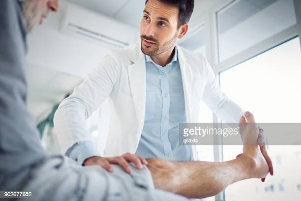 senior man having medical exam. - rheumatoid arthritis stock pictures, royalty-free photos & images