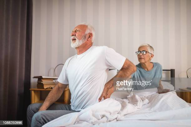 senior man having problem with hernia - ernia foto e immagini stock