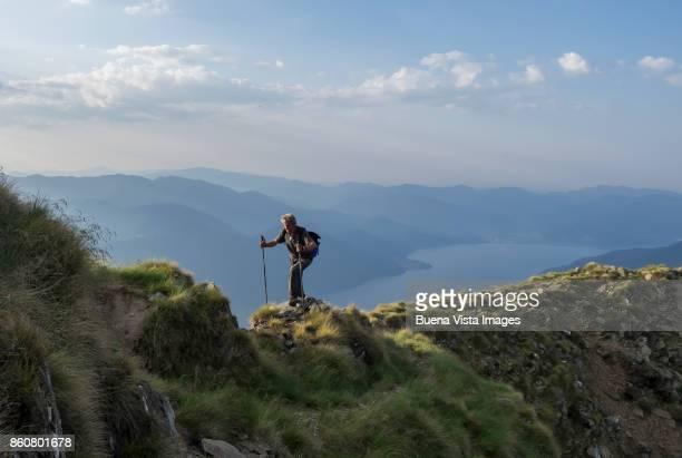 Senior man hiking in mountains