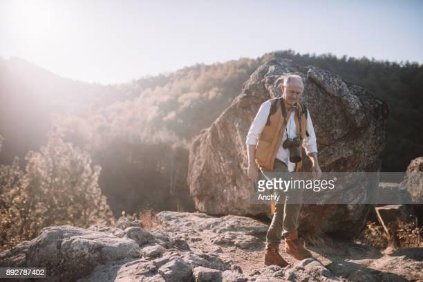 Senior man hiking on a mountain track