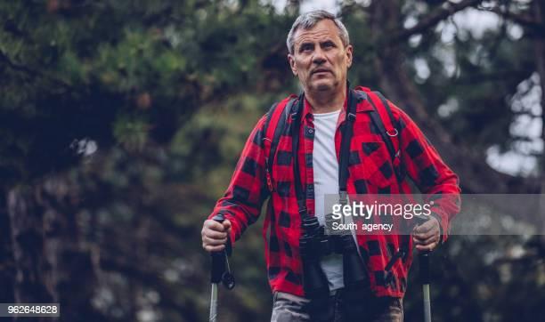 Senior man hiking on mountain