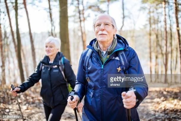 Senior man hiking with friend