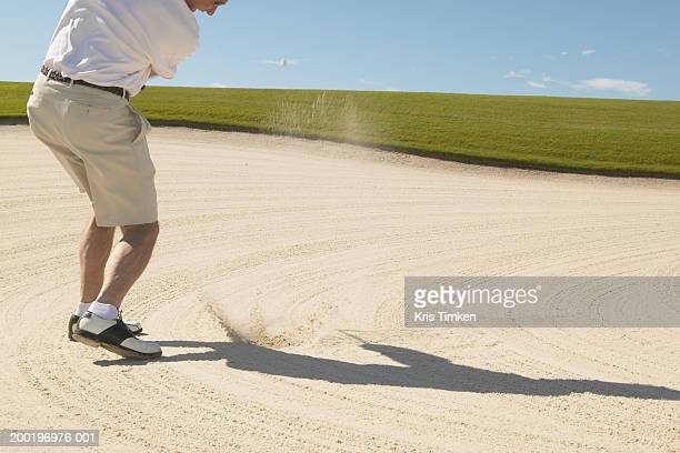 senior man hitting golf ball out of sand trap, rear view - sand trap stock pictures, royalty-free photos & images