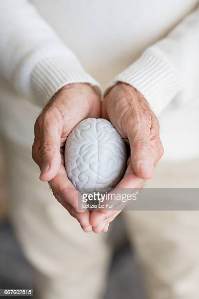 Senior man holding a stress ball