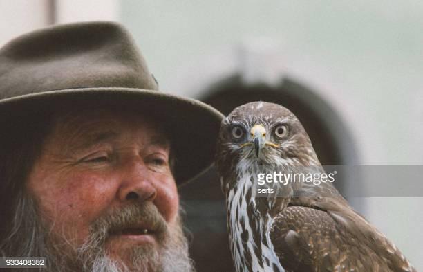Senior man holding an eagle  in Rothenburg ob der Tauber