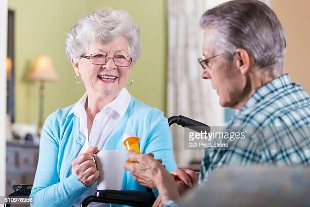 Senior man holds medication bottle