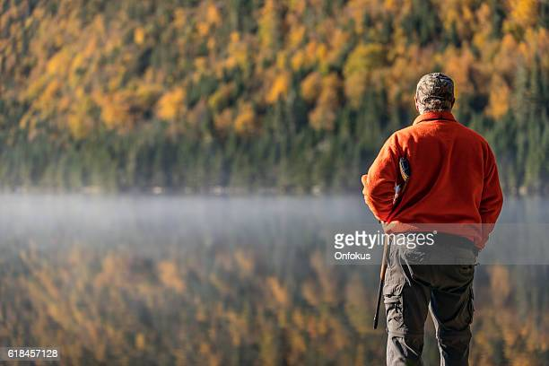 senior man hunter relaxing in nature - hunting stock pictures, royalty-free photos & images