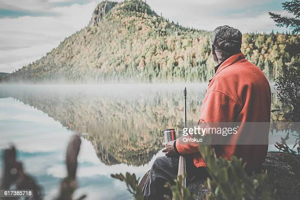 Senior Man Hunter Relaxing with Coffee in Nature