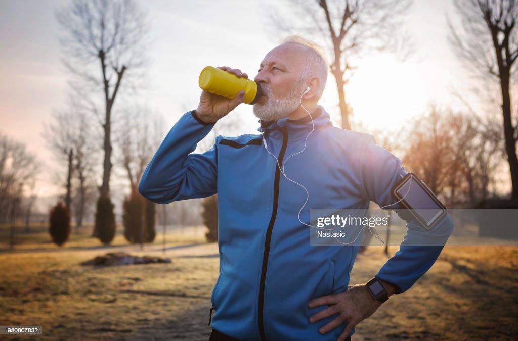 Senior man hydrating : Stock Photo