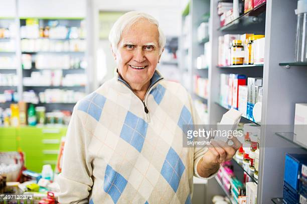 Senior man in a pharmacy.