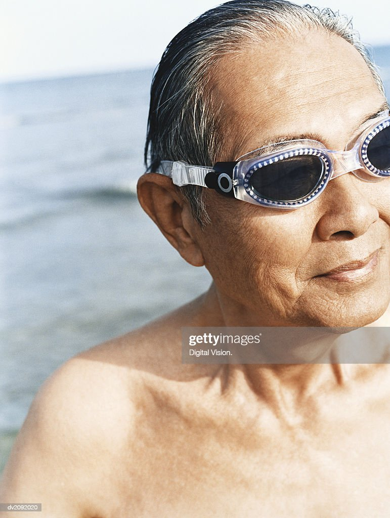 Senior Man in a Swimming Pool, Wearing Swimming Goggles : Stock Photo