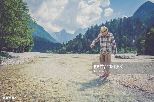senior man in alps - old man feet stock pictures, royalty-free photos & images